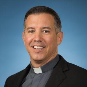 Fr. Manuel Puga, JCL